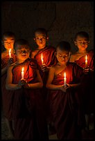 Group of buddhist novices holding candles. Bagan, Myanmar ( color)