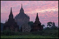 Temples profiled against brilliant sunrise sky. Bagan, Myanmar ( color)