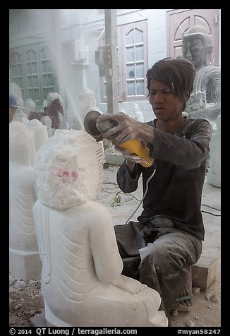 Man carving marble buddha statue with grinder. Mandalay, Myanmar (color)