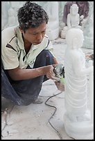 Stone sculptor finishing buddha statue. Mandalay, Myanmar ( color)