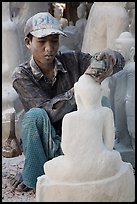 Sculptor carving buddha statue out of a block of white marble. Mandalay, Myanmar ( color)
