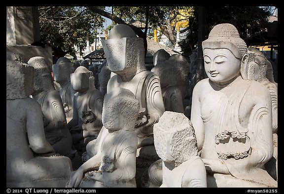 Buddha statues in various stages of completion on Marble street. Mandalay, Myanmar (color)