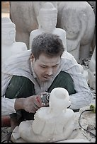 Sculptor with face covered in fine marble dust. Mandalay, Myanmar ( color)