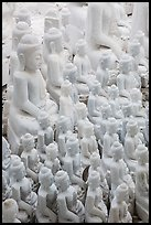 Unfinished white marble buddha statues of various sizes. Mandalay, Myanmar ( color)