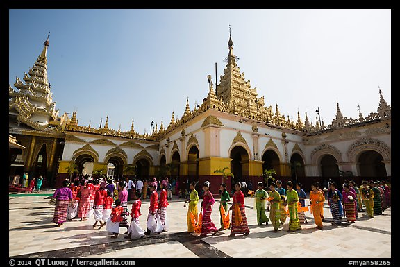 Novices and families walk in procession during Shinbyu ceremony, Mahamuni Pagoda. Mandalay, Myanmar (color)