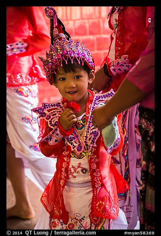 Young girl dressed in glittering attire during novitiation, Mahamuni Pagoda. Mandalay, Myanmar (color)