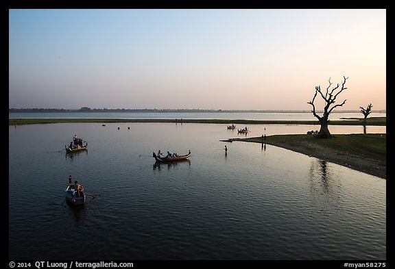 Tree skeletons and boats, Taungthaman Lake. Amarapura, Myanmar (color)