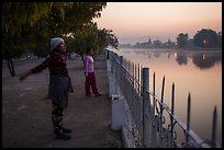 Women exercising next to Mandalay Fort at dawn. Mandalay, Myanmar ( color)