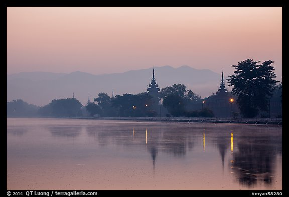 Pagodas reflected in moat at dawn, Mandalay Fort. Mandalay, Myanmar (color)