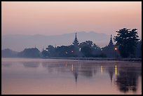 Pagodas reflected in moat at dawn, Mandalay Fort. Mandalay, Myanmar ( color)