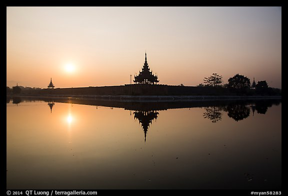Sunrise, Mandalay Fort moat. Mandalay, Myanmar (color)