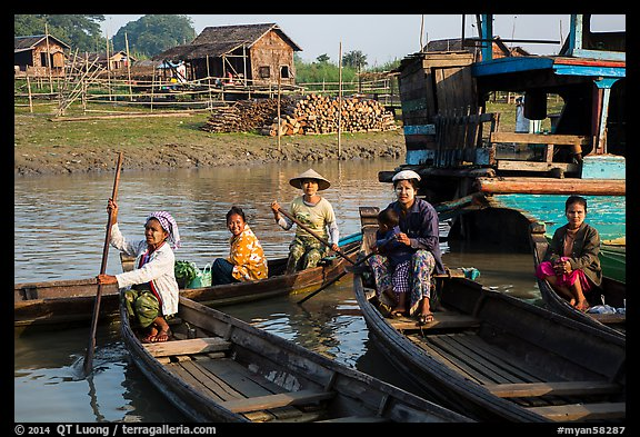 Row boats and huts on shore of Irrawaddy River. Mandalay, Myanmar (color)