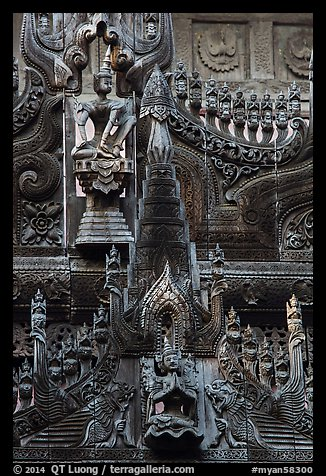 Intricate teak carving, Shwe In Bin Kyaung pagoda. Mandalay, Myanmar (color)