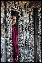 Monk pearing from window, Shwe In Bin Kyaung pagoda. Mandalay, Myanmar ( color)