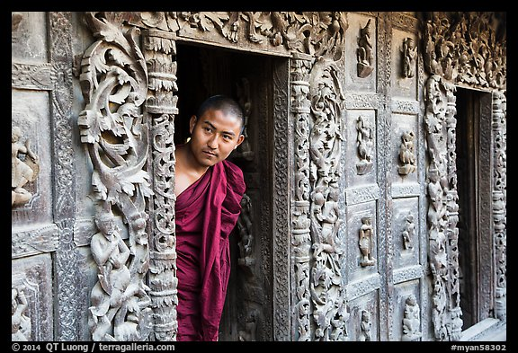 Exquisitely carved teak walls and monk pearing, Shwe In Bin Kyaung pagoda. Mandalay, Myanmar (color)