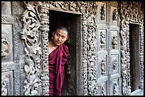 Exquisitely carved teak walls and monk pearing, Shwe In Bin Kyaung pagoda. Mandalay, Myanmar ( color)