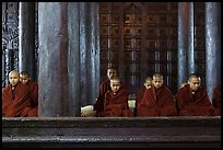 Monks during evening prayer. Mandalay, Myanmar ( color)