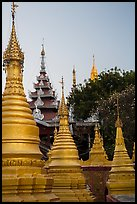 Stupas and spires at dawn, Sutaungpyei Pagoda. Mandalay, Myanmar ( color)