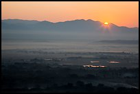 Sun rising over Shan Yoma mountains. Mandalay, Myanmar ( color)