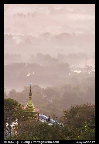 Stupa on Mandalay Hill overlooking misty plain. Mandalay, Myanmar (color)