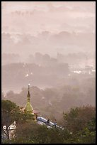 Stupa on Mandalay Hill overlooking misty plain. Mandalay, Myanmar ( color)