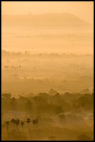 Ridges in mist at sunrise seen from Mandalay Hill. Mandalay, Myanmar ( color)