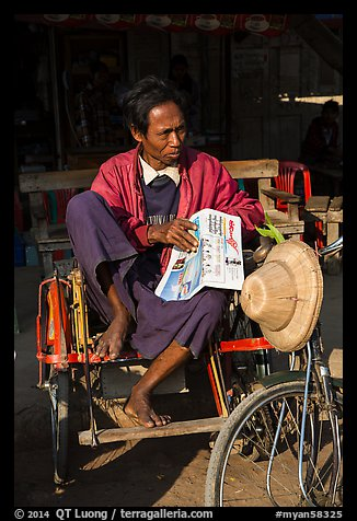 Sai kaa driver sitting on his rickshaw. Mandalay, Myanmar (color)