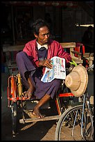Sai kaa driver sitting on his rickshaw. Mandalay, Myanmar ( color)