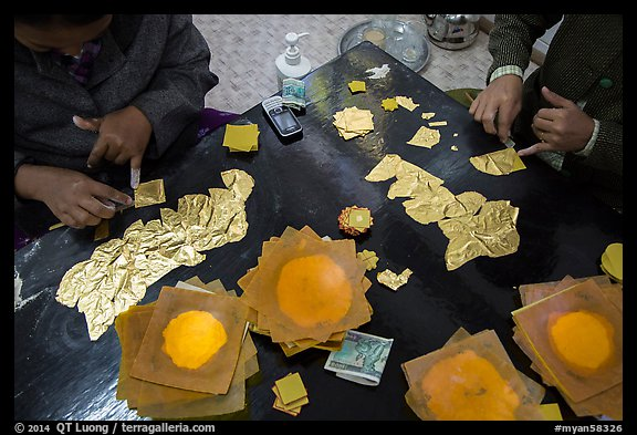 Gossamer-thin pieces of gold cut in squares, gold leaf workshop. Mandalay, Myanmar (color)