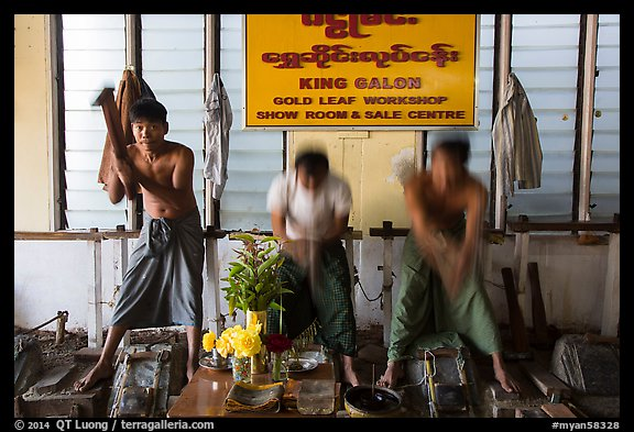 Men beat sheets of gold, gold leaf workshop. Mandalay, Myanmar (color)