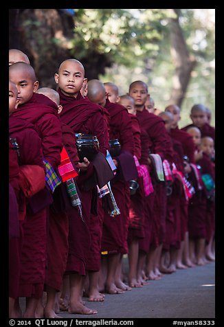 Monks lining up with alms bowls, Mahagandayon Monastery. Amarapura, Myanmar (color)