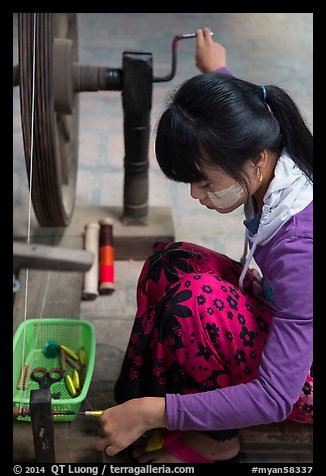 Woman assembling a yarn package. Amarapura, Myanmar (color)