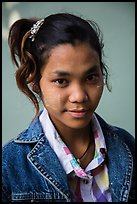 Woman with blue jeans jacket and thanaka paste. Mandalay, Myanmar ( color)