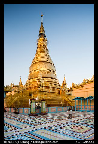 Man praying at main stupa of Soon U Ponya Shin Pagoda. Myanmar (color)