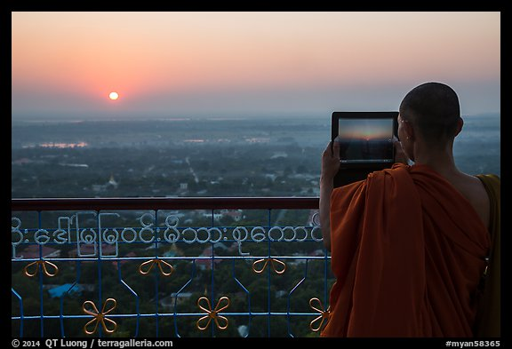 Monk taking picture of sunset from Sagaing Hill. Myanmar (color)