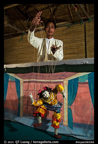 Puppeter handling traditional burmese string marionette. Mandalay, Myanmar (color)