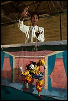 Puppeter handling traditional burmese string marionette. Mandalay, Myanmar ( color)