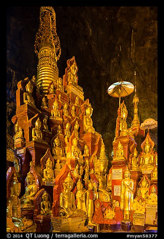 Many buddha images surround main stupa in Pindaya Caves. Pindaya, Myanmar (color)