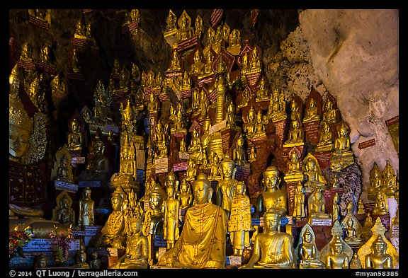 Buddha statues of all sizes near entrance of Pindaya Caves. Pindaya, Myanmar (color)