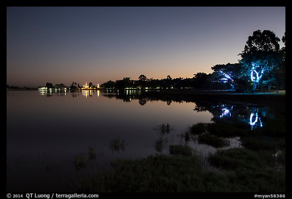 Pone Tanoke Lake at night with illuminated trees and pagoda. Pindaya, Myanmar (color)