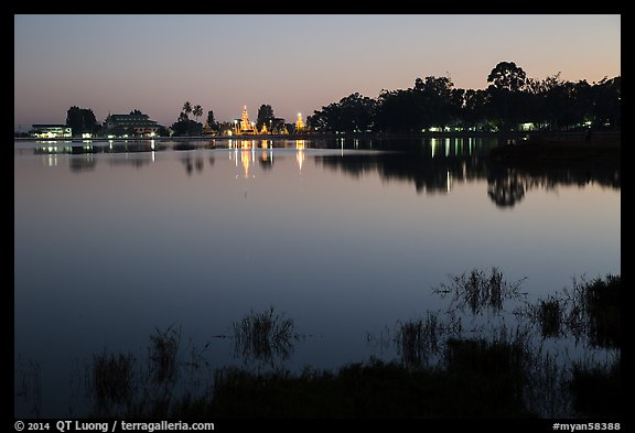 Illuminated pagoda reflected in Pone Tanoke Lake. Pindaya, Myanmar (color)