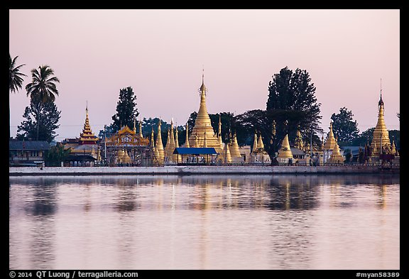 Pagoda reflected in Pone Tanoke Lake at dawn. Pindaya, Myanmar (color)