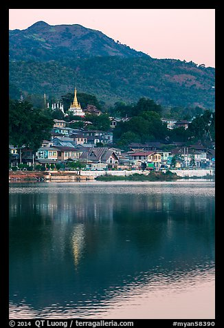 Hill and town reflected in Pone Tanoke Lake at dawn. Pindaya, Myanmar (color)