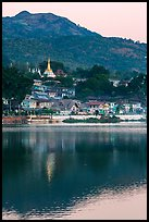 Hill and town reflected in Pone Tanoke Lake at dawn. Pindaya, Myanmar ( color)