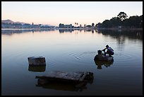 Woman washing laundry in Pone Tanoke Lake at dawn. Pindaya, Myanmar ( color)