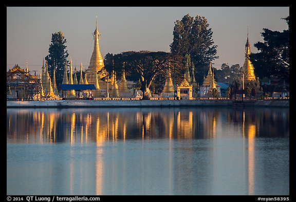 Pagoda reflected in Pone Tanoke Lake at sunrise. Pindaya, Myanmar (color)