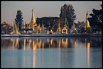 Pagoda reflected in Pone Tanoke Lake at sunrise. Pindaya, Myanmar ( color)