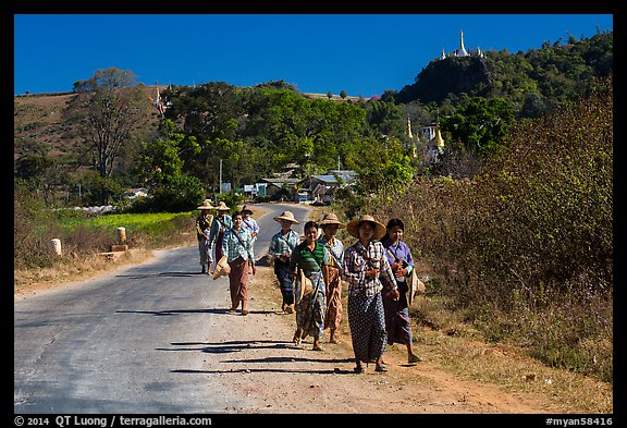 Women walking on road. Shan state, Myanmar (color)