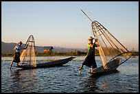 Intha fishermen row with leg and hold conical baskets. Inle Lake, Myanmar ( color)
