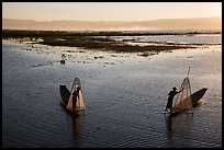 Intha fishermen row with backlit conical nets. Inle Lake, Myanmar ( color)